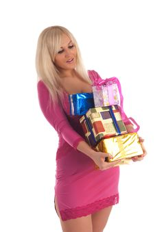 Glamour Girl In A Pink Dress With A Gift In A Hand Royalty Free Stock Photos