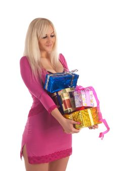 Glamour Girl In A Pink Dress With A Gift In A Hand Royalty Free Stock Image