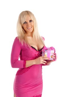 Glamour Girl In A Pink Dress With A Gift In A Hand Stock Photo
