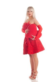 Glamour Girl In A Red Dress With A Gift In A Hand Royalty Free Stock Image