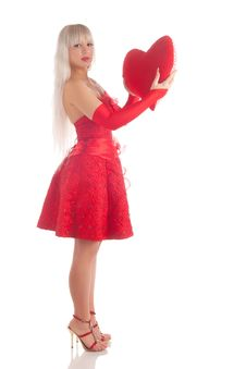 Glamour Girl In A Red Dress With A Gift In A Hand Royalty Free Stock Photo