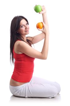 Young Woman With Apple And Orange. Isolated Stock Photo