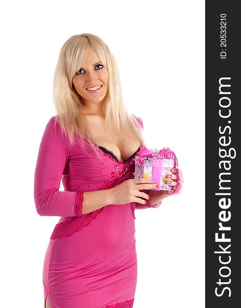 Glamour girl in a pink dress with a gift in a hand