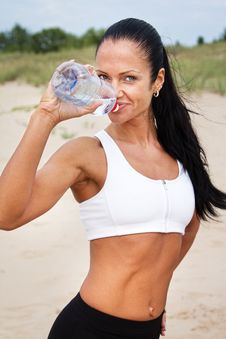 Free Beautiful Fit Girl Drinking Water After Exercises Stock Images - 20540244