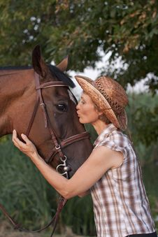 Free Woman In Hat Kissing The Horse. Royalty Free Stock Photos - 20542438