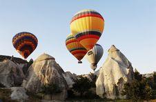 Hot Air Balloons Over Cappodocia Terrain Royalty Free Stock Photo