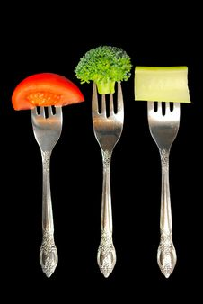 Free Forks With Vegetables On A Black Background Stock Image - 20543681