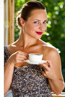 A Young Attractive Woman With A Cup Of Coffe Royalty Free Stock Photos