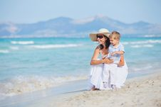Free Young Mother With Her Son On Beach Vacation Royalty Free Stock Images - 20546359