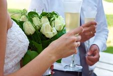 Free Bride And Groom Holding Glasses And Flowers Royalty Free Stock Image - 20546746