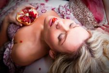 Lying Woman With Pomegranate Royalty Free Stock Photos