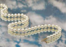 Free Elegant Pearls With Sky Stock Photos - 20548193