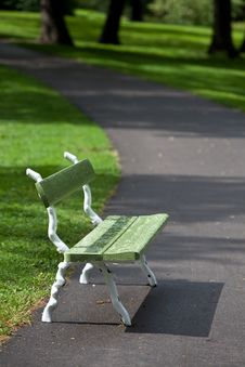 Green Bench In The Park. Stock Photos