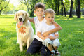 Free Little Boy In The Park With A Dog Royalty Free Stock Photo - 20553055