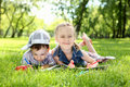 Free Children In The Park Reading A Book Royalty Free Stock Photo - 20553085
