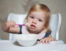 Free Little Girl Eating Porridge Stock Photo - 20551350