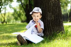 Free Portrait Of A Boy With A Book In The Park Royalty Free Stock Image - 20553106