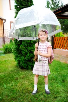 Little Schoolgirl With Backpack And Umbrella Royalty Free Stock Images