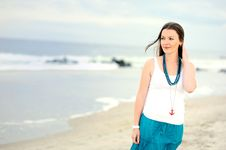 Free Beautiful Young Woman Stands Against Ocean Stock Photos - 20553383