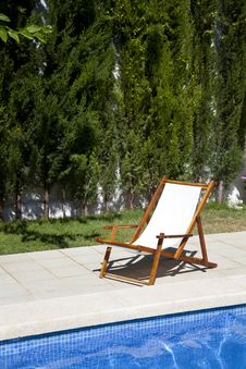 Free Deckchair In A Swimming Pool Stock Image - 20556631