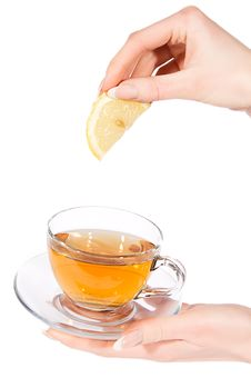 Free Hand Adding Lemon To Tea Stock Photos - 20556843