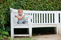 Free Little Boy Sits On A Bench In A Park Royalty Free Stock Photography - 20563777
