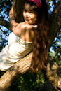 Free Girl Climbing A Tree Stock Images - 20564494