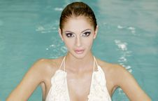 Free Beautiful Young Woman Standing In A Swimming Pool Royalty Free Stock Image - 20561916