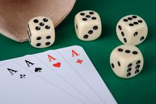 Aces, Dices And Cup On Green Royalty Free Stock Photo