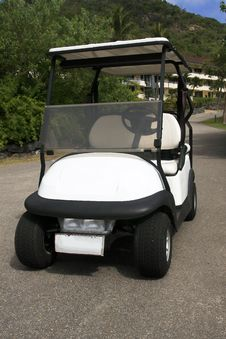 Electric Golf Cart Parked On Road. Stock Photo
