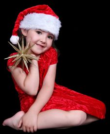 Little Girl In Santa Hat With Golden Star. Stock Photos