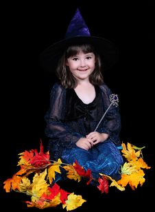 Fun Little Witch Surrounded By Golden Leaves Stock Photo