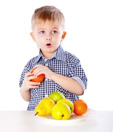 Free A Boy And The Plate Of Fruits Stock Photo - 20567290