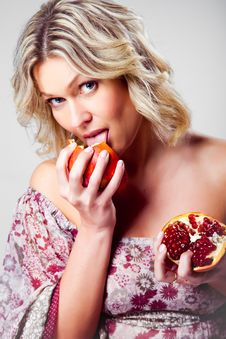 Free Blonde Woman Licking Pomegranate On Grey Stock Photos - 20568143