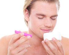 Free Man Smelling On Creme Stock Photo - 20568690