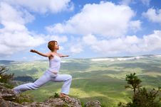 Free Female Gymnastics On The Rock Royalty Free Stock Photo - 20569265