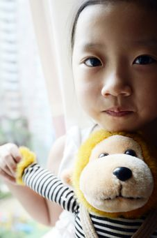 Free Asian Child Holding The Toy Monkey Stock Photos - 20570663