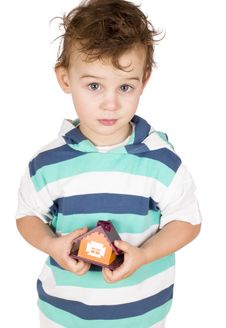 Free Little Boy Holding A Toy House Stock Image - 20570731