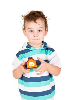 Free Little Boy Holding A Toy House Stock Images - 20570764