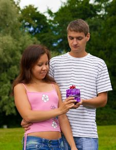 Free Young Man Giving Present To Girlfriend Stock Photography - 20571442