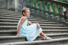 Free Beautiful Girl Sits On On The Stairs In A Park Royalty Free Stock Image - 20575206