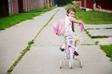 Free Young School Girl With Pink Bagpack On A Bicycle Royalty Free Stock Image - 20576336
