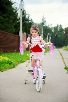 Free Young School Girl Rides Her Pink Bicycle Stock Photo - 20576340