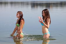 Free Two Girls In Bikini Play In A Water Stock Photo - 20577050