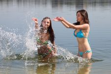 Free Two Girls In Bikini Play In A Water Stock Image - 20577051