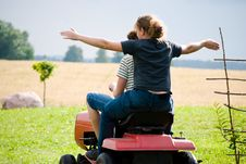 Free Boy And Girl Enjoy Driving A Tractor Stock Photo - 20578920