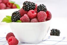 Free Raspberries And Blackberries In A White Bowl Stock Photo - 20579350
