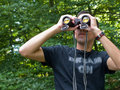 Free Young Man Looking Through Binoculars Stock Photography - 20588292
