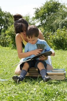 Free Mum And The Son Reads The Book Stock Photo - 20582820