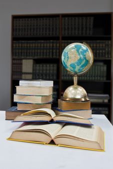 Free Pile Of Books And Globe Stock Photo - 20585080